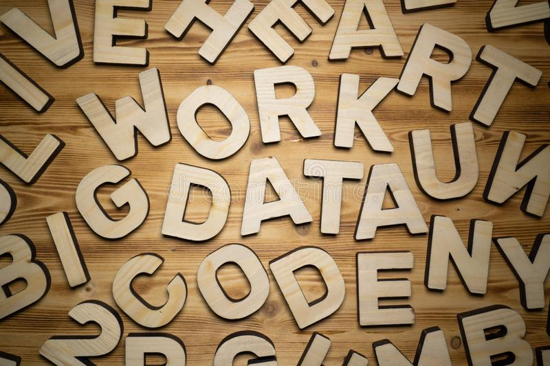 Pile of wooden block letters words over the wooden background.  royalty free stock images