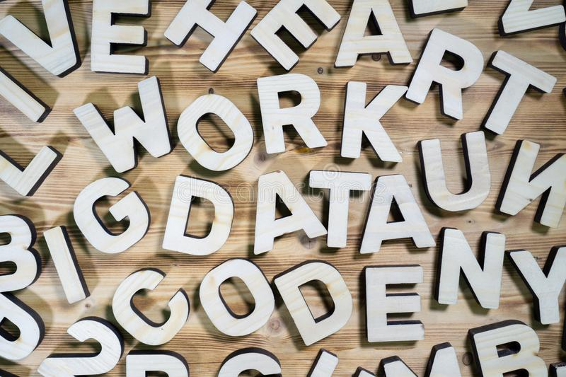 Pile of wooden block letters words over the wooden background.  stock images