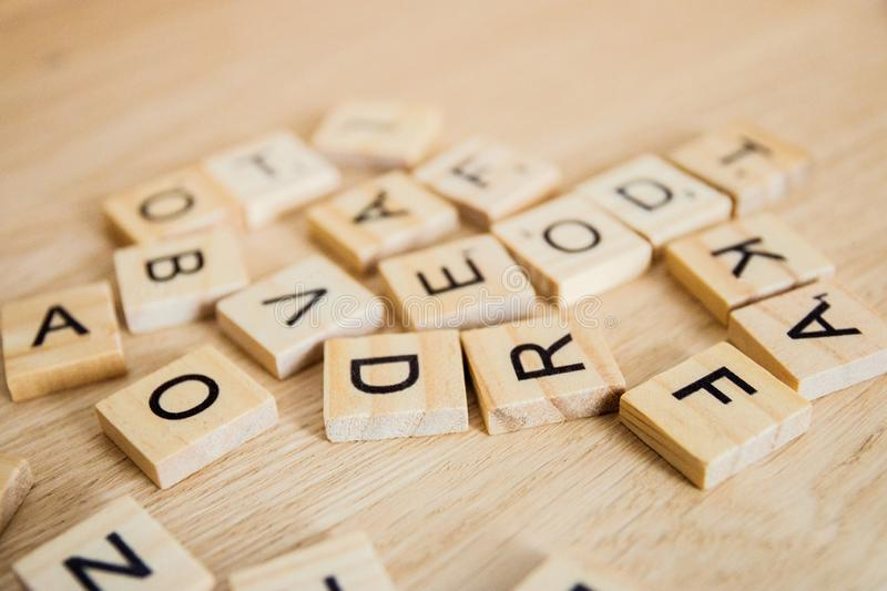 Pile of wooden letters on the surface of a wooden background, selective focus royalty free stock photography