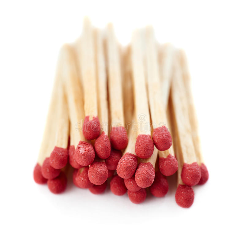 Pile of Wooden matches isolated over the white background royalty free stock photography