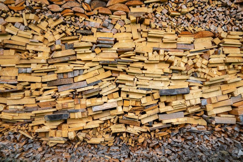 Pile of wooden pieces used for firewood stock photos