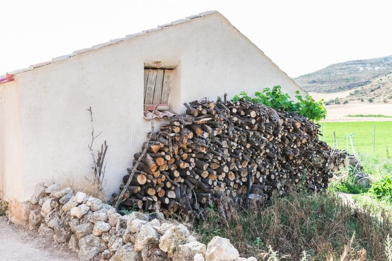 Pile of woods on house facade royalty free stock photos