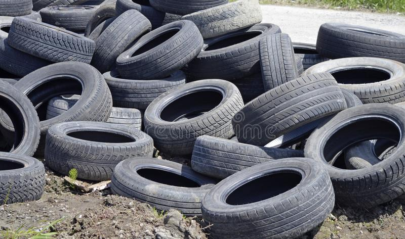 Pile of worn out old tires stock image
