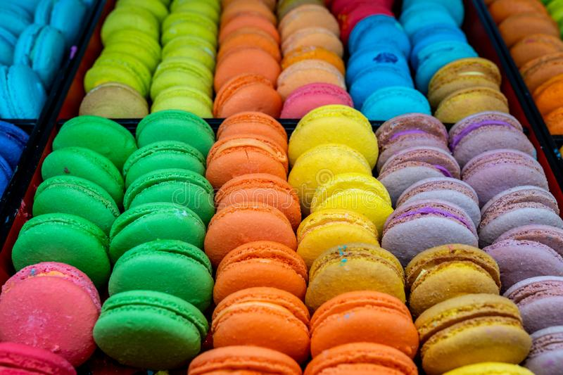 Pile of yummy and colorful macarons for sale at patisserie royalty free stock photos