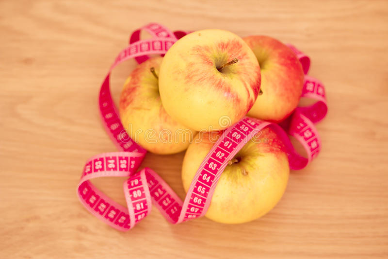 Download Piled Apples And Measuring Tape: Eating Healthy Stock Photo - Image: 27368468