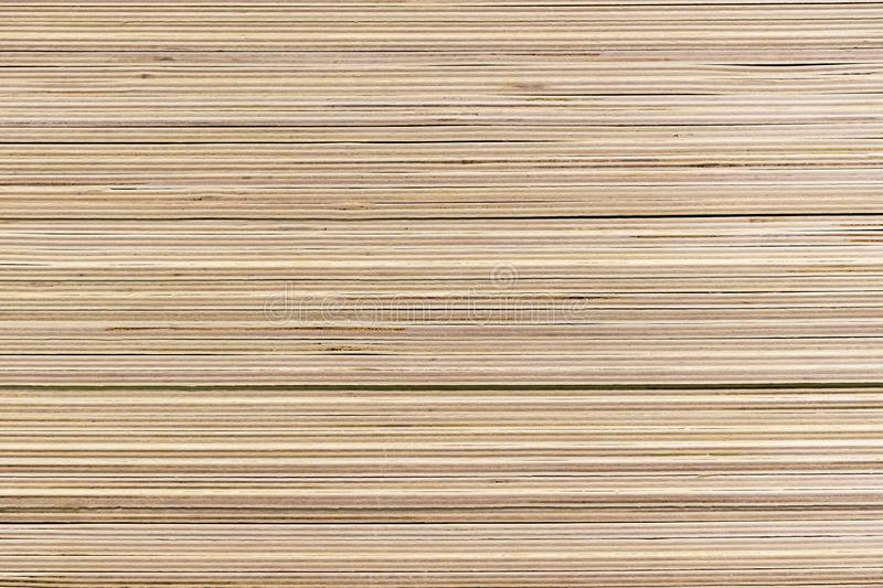 Piled sheets of plywood in a building materials store.  stock photo
