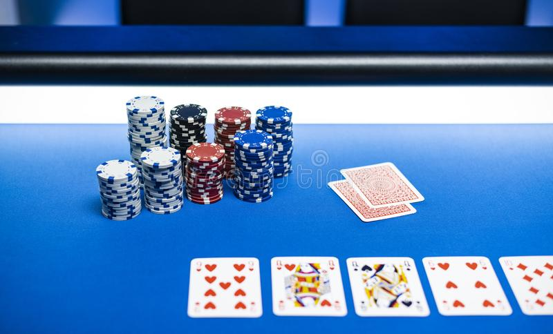 Piles of chips and Texas Hold `em poker cards royalty free stock image