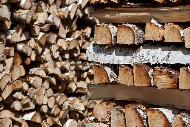 Piles of chopped birch wood royalty free stock photo
