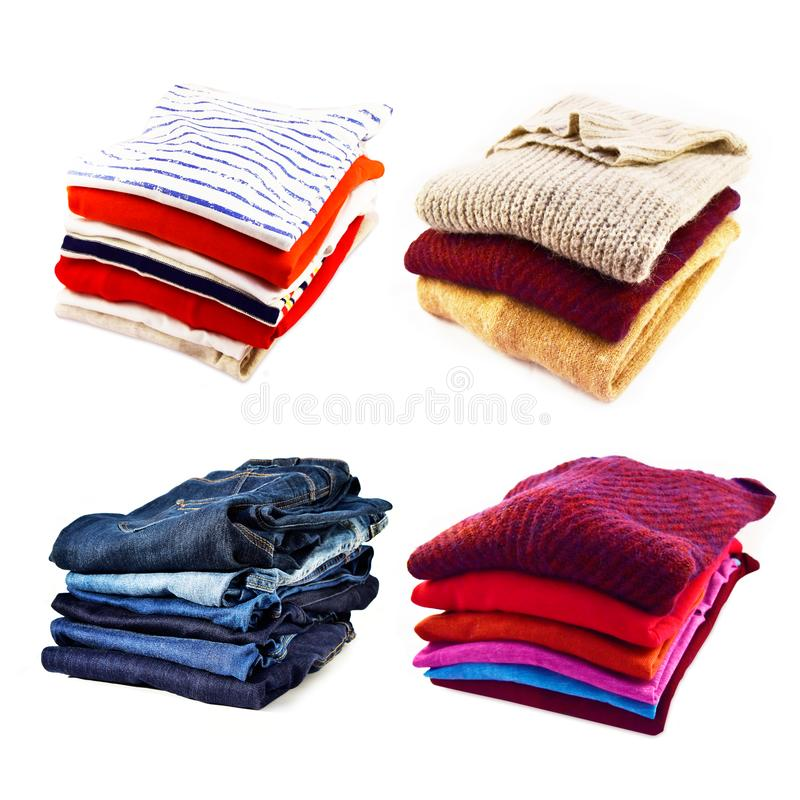 Piles of clothes and jeans on white background royalty free stock image