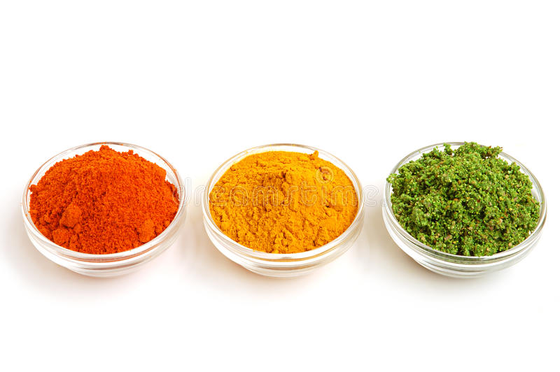 Piles of color spices royalty free stock image