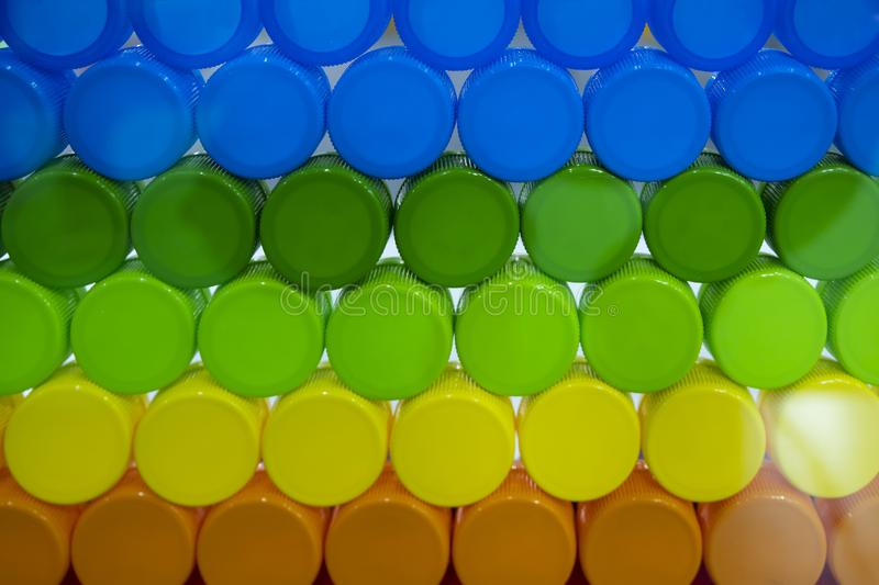 The piles of colorful the plastic caps. Product of polymer royalty free stock photography