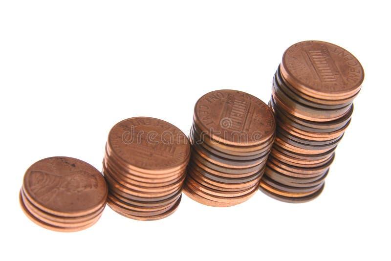 Piles croissantes des pièces de monnaie. image stock