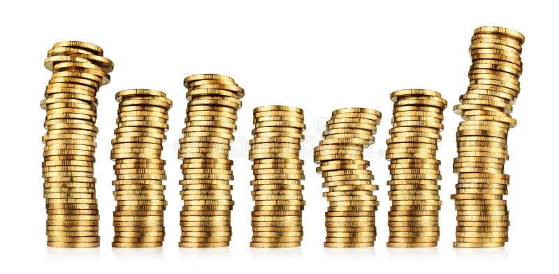 Piles de pièces d'or photographie stock libre de droits