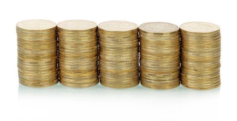 Piles de pièces de monnaie images libres de droits