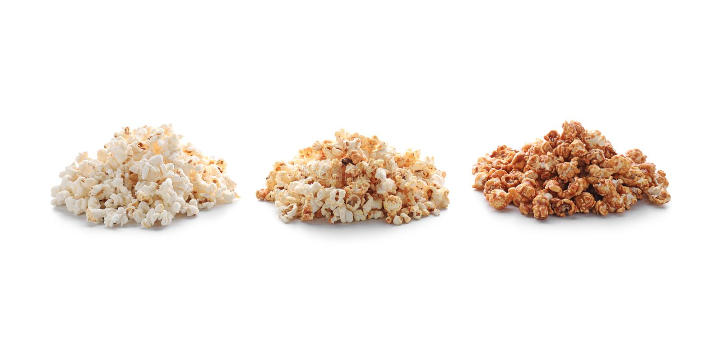 Piles of delicious popcorn on white background stock photos