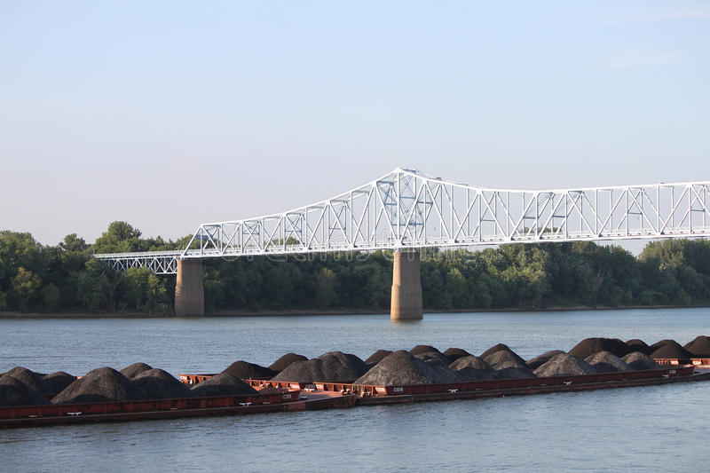 Piles of dirt on river in Owensboro. Visiting Owensboro, Kentucky and saw this barge come through and took a picture. This picture was taken over Smother's Park stock image