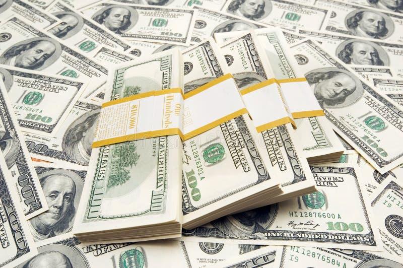 Piles Du Dollar De Dix-millièmes Sur Le Fond D Argent Photo stock