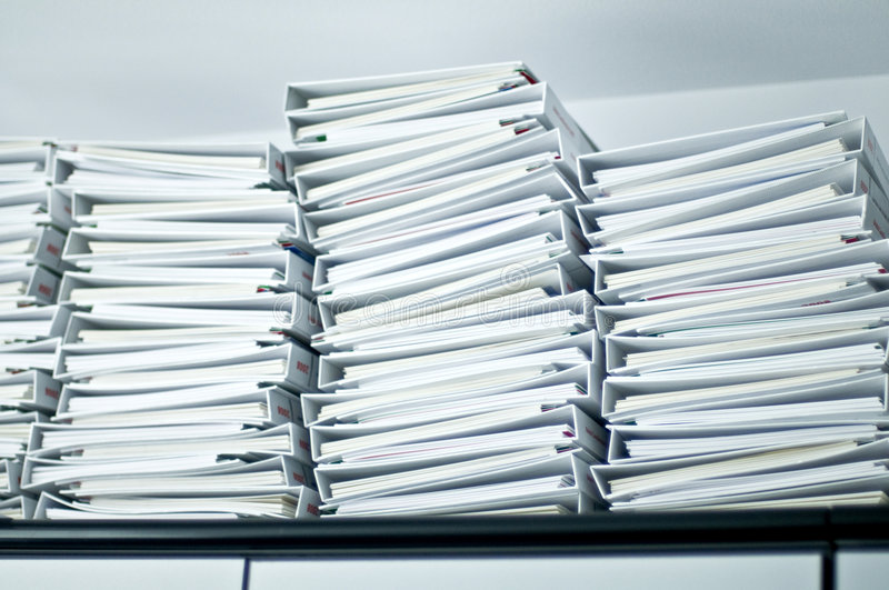 Piles of folders in office royalty free stock image