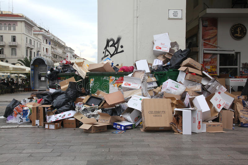 Piles of garbage in the center of Thessaloniki. THESSALONIKI, GREECE - DECEMBER 27: Piles of garbage in the center of Thessaloniki on December 27, 2010 in royalty free stock photography