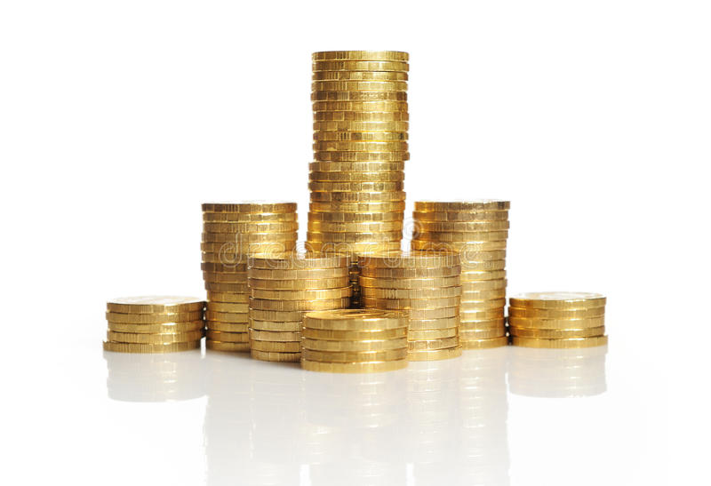 Piles of gold coins stock photos