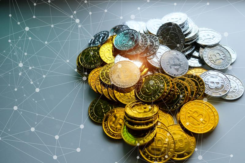 Among piles of golden and silver bitcoin and blockchain nodes all around . Blockchain transfers virtual cryptocurrency concept royalty free stock images
