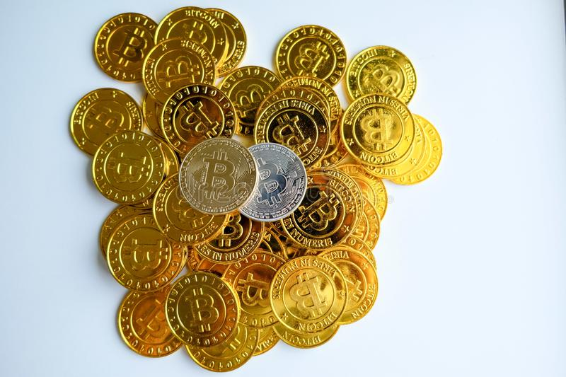 Among piles of golden and silver bitcoin and blockchain nodes all around . Blockchain transfers virtual cryptocurrency concept.  stock photos