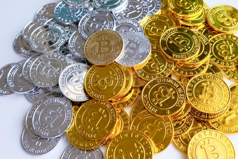 Among piles of golden and silver bitcoin and blockchain nodes all around . Blockchain transfers virtual cryptocurrency concept.  royalty free stock photos