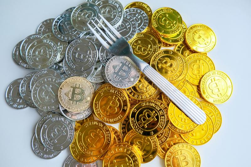 Among piles of golden and silver bitcoin and blockchain nodes all around . Blockchain transfers virtual cryptocurrency concept.  stock photo