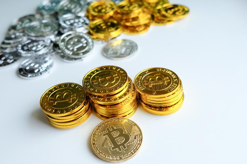 Among piles of golden and silver bitcoin and blockchain nodes all around . Blockchain transfers virtual cryptocurrency concept.  royalty free stock image