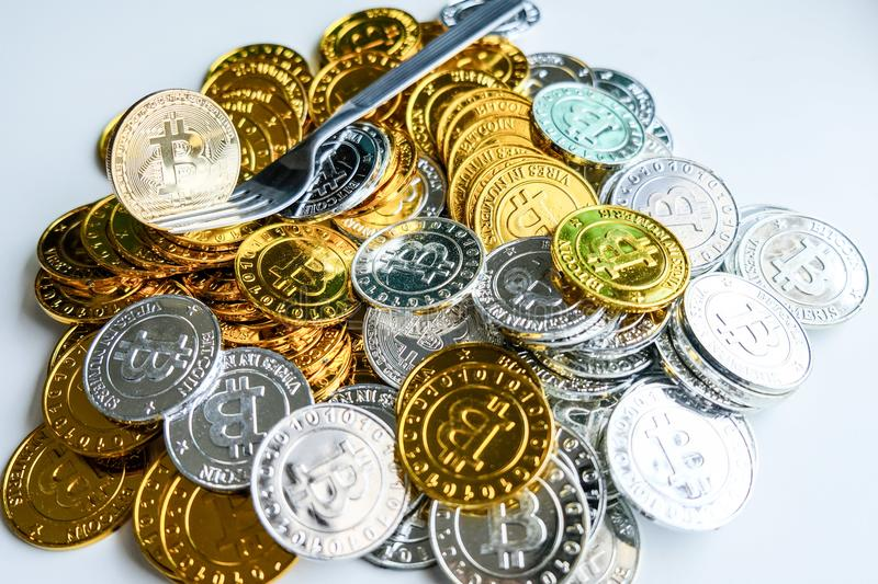 Among piles of golden and silver bitcoin and blockchain nodes all around . Blockchain transfers virtual cryptocurrency concept.  royalty free stock photography