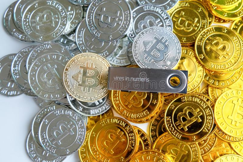 Among piles of golden and silver bitcoin and blockchain nodes all around . Blockchain transfers virtual cryptocurrency concept.  stock images