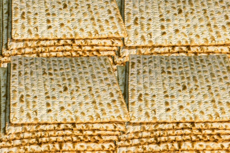 Piles of Jewish Matzah bread, substitute for bread on the Jewish Passover holiday. Pesach matzo background royalty free stock images