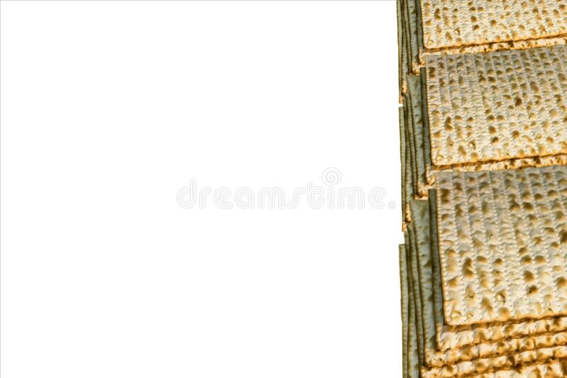 Piles of Jewish Matzah bread, substitute for bread on the Jewish Passover holiday. Pesach matzo on white background stock photography