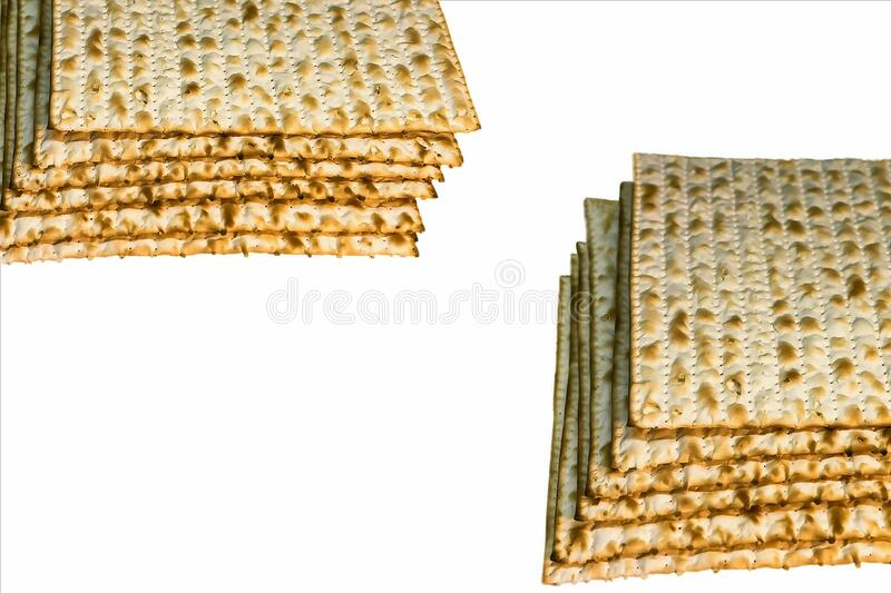 Piles of Jewish Matzah bread, substitute for bread on the Jewish Passover holiday. Pesach matzo on white background royalty free stock photography
