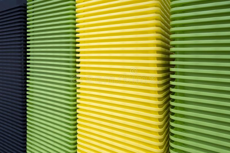 Background of piles of multi-colored plastic containers at an exhibition in a store. Piles of multi-colored plastic containers at an exhibition in a store stock images