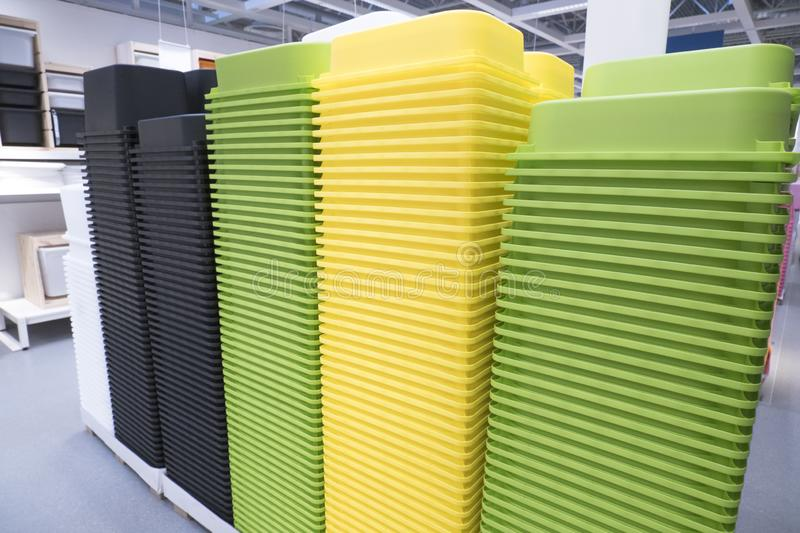Piles of multi-colored plastic containers at exhibition in a store. Piles of multi-colored plastic containers at an exhibition in a store stock images