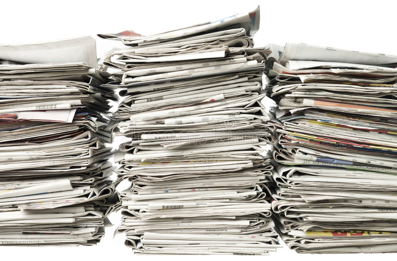 Piles of newspapers stock images