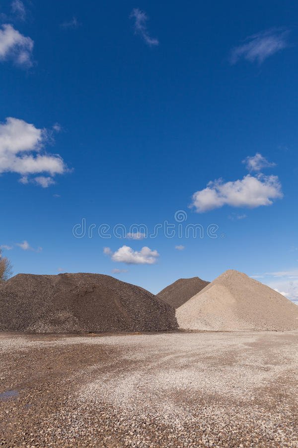 Free Piles Of Gravel At Construction Site Under Bright Blue Sky Royalty Free Stock Photos - 52551548