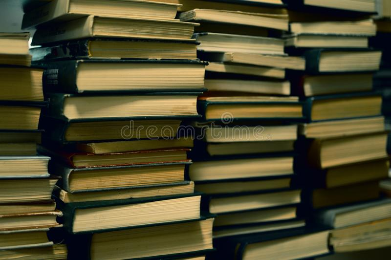 Piles of old books in library stock image