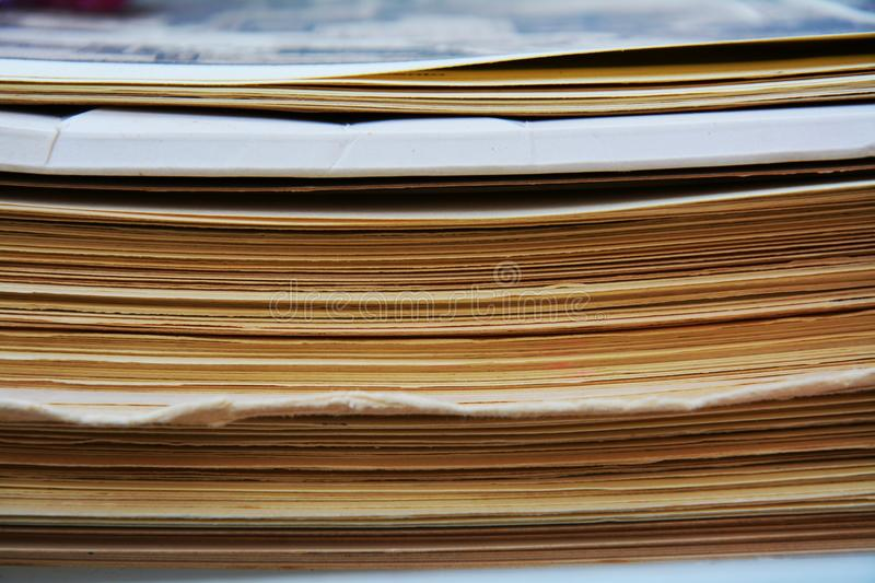 Piles of old magazines. Piles of old trash magazines background, vintage image royalty free stock images