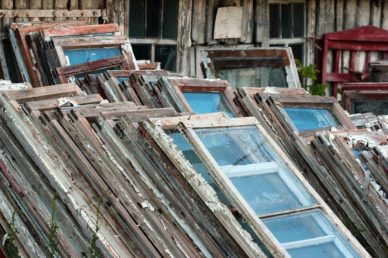 Piles of old wooden frames and windows royalty free stock photo