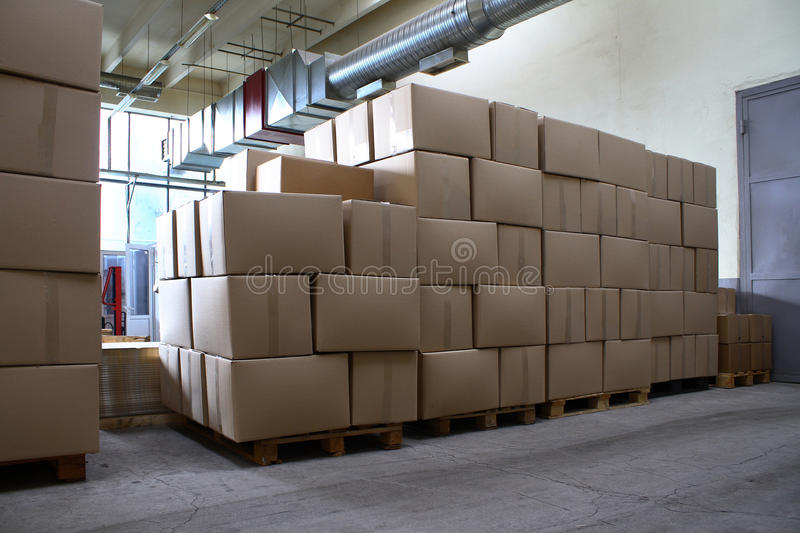 Piles of paper boxes with goods in storage royalty free stock photo