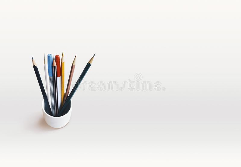 A piles of pencils mixed color and magic pens on white background with copy space. Writing concept. Top view of a piles of pencils with nibs mixed color and stock image