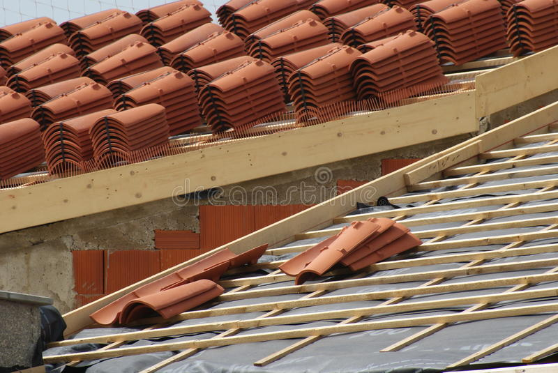 Piles of roofing-tiles on a house. Making a roof in France with roofing-tiles royalty free stock images