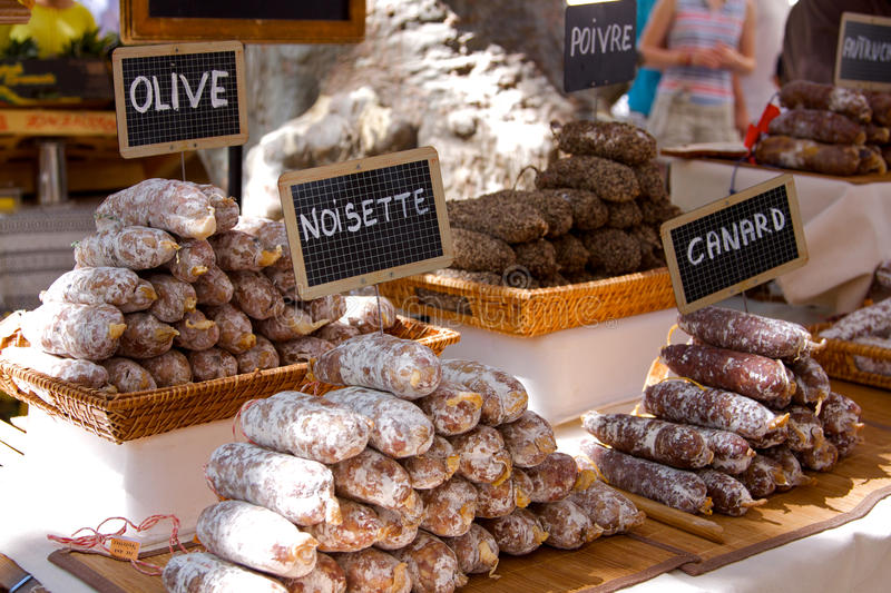 Piles of Saucisson. On a french market stall in Provence stock images