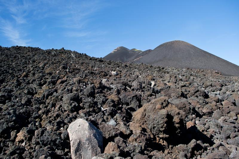 Piles of sloped black lava under the Etna volcano royalty free stock photos
