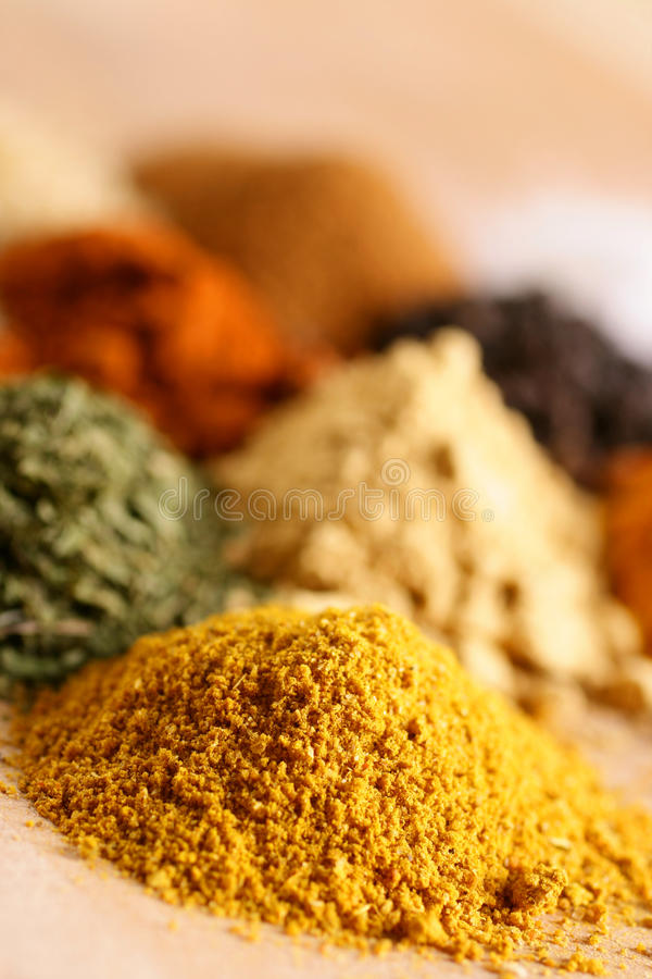 Piles of spices. Piles of aroma color spices stock images