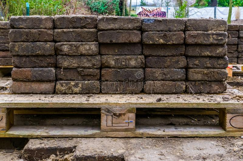 Piles of street paving stacked on a pallet, construction industry background stock photography