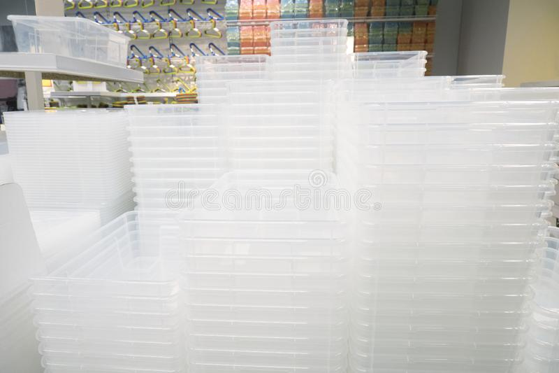 Piles of white transparent plastic containers at exhibition in a store. Piles of white transparent plastic containers at an exhibition in a store stock photos