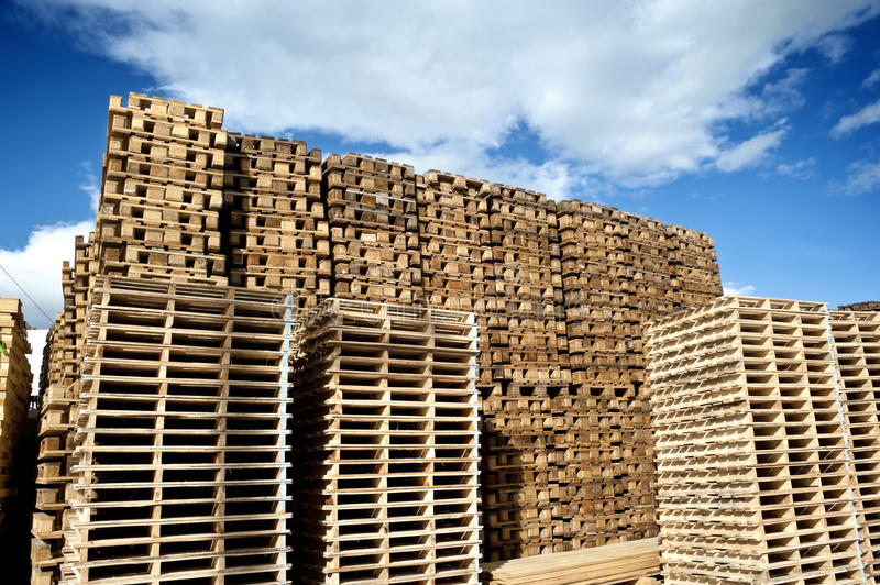 Piles of wooden pallets. Piles of industrial wooden pallets stock photos